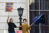 Peoples Vote March for the Future. London protest demanding a second referendum on the Brexit deal. Young protestors shout their message from Government buildings in Whitehall - Stefano Cagnoni - 2010s,2018,activist,activists,against,BREXIT,buildings,Cabinet Office,CAMPAIGNING,CAMPAIGNS,Democracy,DEMONSTRATING,demonstration,EU,Europe,European,European flag,European Union,europeans,FEMALE,flag,