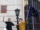Peoples Vote March for the Future. London protest demanding a second referendum on the Brexit deal. Young protestors shout their message from Government buildings in Whitehall - Stefano Cagnoni - 2010s,2018,activist,activists,against,BREXIT,buildings,Cabinet Office,CAMPAIGNING,CAMPAIGNS,Democracy,DEMONSTRATING,demonstration,EU,Europe,European,European flag,European Union,europeans,flag,flags,G