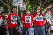 Oakland, California, USA- Hotel workers strike against low pay at the Marriott City Center Hotel. Members of Unite Here protest at low wages that force many workers to work an additional job besides t... - David Bacon - 20-10-2018