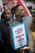Rise of precarious workers protest, supporting Uber drivers for employment rights in the High Court, organised by IWGB trade union, London - Jess Hurd - 2010s,2018,activist,activists,against,BAME,BAMEs,BEMM,BEMMS,Black,BME,bmes,CAMPAIGNING,CAMPAIGNS,contracts,Court,DEMONSTRATING,demonstration,diversity,DRIVER,drivers,DRIVING,EARNINGS,employment,employ