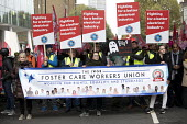 Foster Care Workers, Rise of precarious workers protest, supporting Uber drivers for employment rights in the High Court, organised by IWGB trade union, London - Jess Hurd - 2010s,2018,activist,activists,against,BAME,BAMEs,banner,banners,BEMM,BEMMS,Black,BME,bmes,CAMPAIGNING,CAMPAIGNS,contracts,Court,DEMONSTRATING,demonstration,diversity,DRIVER,drivers,DRIVING,EARNINGS,em