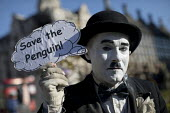 Extinction Rebellion nonviolent direct action against climate change, Parliament Square, London. Save the Penguin! - Jess Hurd - 2010s,2018,activist,activists,against,animal,animals,bird,birds,campaign,campaigner,campaigners,campaigning,CAMPAIGNS,charlie chaplin,civil disobedience,Climate Change,costume,costumes,DEMONSTRATING,d