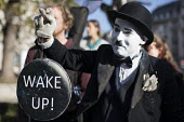 Campaigner dressed as Charlie Chaplin, Extinction Rebellion launching nonviolent direct action against climate change, Parliament Square, London. - Jess Hurd - 2010s,2018,activist,activists,against,campaign,campaigner,campaigners,campaigning,CAMPAIGNS,charlie chaplin,civil disobedience,Climate Change,costume,costumes,DEMONSTRATING,demonstration,DEMONSTRATION