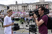 Australian TV news reporting from Trafalgar Square, London protest against visit to UK by US President Donald Trump - Stefano Cagnoni - 2010s,2018,activist,activists,against,anti-Trump,bridges not walls,broadcaster,camera,camera operator,cameraman,cameras,CAMPAIGNING,CAMPAIGNS,Channel 9 News,communicating,communication,DEMONSTRATING,d