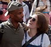 Couple walking together arm in arm London summer 2018 - Stefano Cagnoni - 2010s,2018,adult,adults,BAME,BAMEs,Black,black and white,BME,bmes,boyfriend,BOYFRIENDS,couple,COUPLES,diversity,ethnic,ethnicity,FEMALE,friends,girlfriend,leisure,LFL,LIFE,London,male,man,man and woma