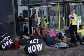 Extinction Rebellion glueing themselves to the Department of Energy, Westminster, London in protest against lack of Government action on climate change - Jess Hurd - 12-11-2018