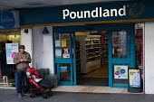 Father and child at Poundland, Catford Shopping Centre, Lewisham, South London. - Jess Hurd - 2010s,2018,buying,Catford,child,CHILDHOOD,CHILDREN,commodities,commodity,consumer,consumers,customer,customers,excluded,exclusion,Father,FATHERS,HARDSHIP,impoverished,impoverishment,INEQUALITY,juvenil
