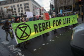 Extinction Rebellion Swarming protest against lack of Government action on climate change. Nonviolent direct action simultaneous blocking roads, Tower Bridge, London - Jess Hurd - 21-11-2018
