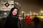 Jeff Bezos mask, Grim Reaper. Amazon workers protest against working conditions, Black Friday, Rugeley, Staffordshire - John Harris - ,2010s,2018,activist,activists,against,CAMPAIGNING,CAMPAIGNS,DEMONSTRATING,Demonstration,depot,DEPOTS,gate,gates,GMB,Grim Reaper,Jeff Bezos,long hours,mask,member,member members,members,night shift,ni