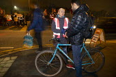 Amazon workers protest against working conditions, Black Friday, Rugeley, Staffordshire. GMB organiser talking to a migrant worker - John Harris - ,2010s,2018,ACTIVIST,ACTIVISTS,against,bicycle,bicycles,BICYCLING,Bicyclist,Bicyclists,BIKE,BIKES,CAMPAIGNING,CAMPAIGNS,communicating,communication,conversation,cycle,cycles,cycling,Cyclist,Cyclists,D