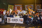 Amazon workers protest against working conditions, Black Friday, Rugeley, Staffordshire. We are not robots - John Harris - 2010s,2018,activist,activists,against,banner,banners,CAMPAIGNING,CAMPAIGNS,DEMONSTRATING,Demonstration,depot,DEPOTS,FBU,GMB,member,member members,members,night time,people,placard,placards,poor condit