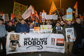 Amazon workers protest against working conditions, Black Friday, Rugeley, Staffordshire. We are not robots - John Harris - 2010s,2018,activist,activists,against,banner,banners,CAMPAIGNING,CAMPAIGNS,DEMONSTRATING,Demonstration,depot,DEPOTS,GMB,member,member members,members,night time,people,placard,placards,poor conditions