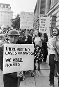 Housing protest outside the Greater London Council, County Hall, London 1980 but directed more against the government of Margaret Thatcher. - Martin Mayer - 1980,1980s,activist,activists,against,CAMPAIGNING,CAMPAIGNS,Council,DEMONSTRATING,Demonstration,GLC,government,Housing,housing shortage,housing stock,local authority,London,outside,placard,placards,Pr
