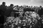 Funeral of Maire Drumm, Vice pres of Sein Fein, 1976 she was shot dead in hospital by the Ulster loyalist 'Red Hand Commando'. A mountain of flowers on the grave - Martin Mayer - 27-11-1976