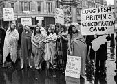 Troops Out Movement vigil; women wearing just blankets take part in a vigil in Trafalgar Square, London, in support of IRA hunger strikers, who refused to wear prison clothes - Martin Mayer - 1970s,1978,activist,activists,against,BLANKET,blanket protest,blankets,CAMPAIGNING,CAMPAIGNS,catholic,catholics,clothes,DEMONSTRATING,Demonstration,FEMALE,hunger,hunger strikers,imprisonment,incarcera
