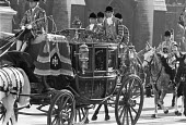 Queen arriving in a horse drawn carriage, State opening of Parliament, London 1980 The Irish State Coach - NLA - 1980,1980s,2nd,AFFLUENCE,AFFLUENT,animal,animals,ARRIVAL,arrivals,arrive,arrives,arriving,Bourgeoisie,carriage,CARRIAGES,cities,City,Domesticated Ungulates,elite,elitism,Elizabeth,equestrian,equine,Fo