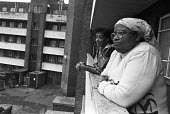 Hackney, East London, residents on a housing estate 1981 - NLA - 1980s,1981,BAME,BAMEs,Black,BME,bmes,cities,City,Council Housing,Council Housing,diversity,ethnic,ethnicity,excluded,exclusion,FEMALE,flat,flats,ghetto,Hackney,HARDSHIP,housing,housing estate,impoveri