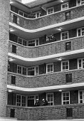 Squatters evicted from Kilner House, Kennington, South London 1981 by bailiffs supported by police who secured the estate. The squat was large, well-organised and peaceful. The flats were later refurb... - NLA - 09-01-1981
