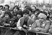 Asian youths listening to speeches, protest against the Conservative Immigration Bill, Trafalgar Square, London 1981 - NLA - 1980s,1981,activist,activists,against,Anti Racism,anti racist,Asian,Asian youths,Asians,attention,attentive,BAME,BAMEs,bigotry,Black,BME,bmes,British Nationality Act 1981,CAMPAIGNING,CAMPAIGNS,DEMONST