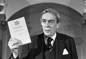 Lord Scarman with his Report on the Brixton Riots, London 1981 - NLA - 1980s,1981,Brixton riots,Law Lord,London,Lord Scarman,POL,political,POLITICIAN,POLITICIANS,Politics,press conference,Public Enquiry,rebellion,revolt,Riot,Rioting,Riots,Scarman report,violence,violent