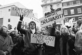 Protest against martial law in Poland, Polish Embassy, London 1981, introduced by General Jaruzelski in an attempt to crush political opposition - NLA - 1980s,1981,activist,activists,against,CAMPAIGNING,CAMPAIGNS,communism,Communist Party,DEMONSTRATING,Demonstration,Jaruzelski,London,martial law,placard,placards,Poland,Polish,Protest,PROTESTER,PROTEST
