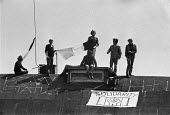Irish prisoners rooftop protest, Gartree prison, Leicestershire 1978. In solidarity with IRA prisoners calling for the restoration of political status in Northern Ireland prisons - NLA - 1970s,1978,activist,activists,against,banner,banners,CAMPAIGN,campaigner,campaigners,CAMPAIGNING,CAMPAIGNS,catholic,catholics,conflict,DEMONSTRATING,Demonstration,DEMONSTRATIONS,flag,flags,Gartree,imp