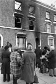 New Cross fire, where 13 young people died Deptford London 1981. The blaze broke out from inside the house, either accidentally or deliberately, during a birthday party at the house, Local residents l... - Peter Arkell - 1980s,1981,arson,attack,attacking,attacks,BAME,BAMEs,bigotry,Black,BME,bmes,burn,burning,BURNS,burnt out,cities,City,communities,community,death,deaths,destroyed,destruction,died,DISCRIMINATION,divers
