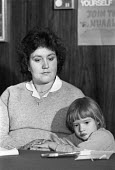 1983 Irene Hogben, with her daughter Kerry, at a press conference held by the agricultural workers union on the dangers of the 245T herbicide. Kerry was born in May 1976 with a hole in the heart, a de... - Peter Arkell - 17-02-1983