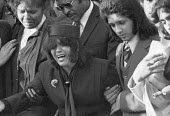 Funerals of Yvonne Ruddock and Paul Ruddock victims of the New Cross house fire London 1981. Their mother and other relatives are grief stricken - Peter Arkell - 1980s,1981,arson,attack,attacking,attacks,BAME,BAMEs,bigotry,Black,BME,bmes,burn,burning,BURNS,burnt out,cities,City,communities,community,cry,crying,death,deaths,destroyed,destruction,died,DISCRIMINA