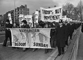 Bloody Sunday commemoration march. The Troops Out Movement, London 1977 - Peter Arkell - 1970s,1977,activist,activists,against,banner,banners,Bloody,Bloody Sunday,CAMPAIGN,campaigner,campaigners,CAMPAIGNING,CAMPAIGNS,catholic,catholics,COMMEMORATE,COMMEMORATING,commemoration,COMMEMORATION