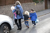 A childminder looking after children, Bristol - Paul Box - ,2010s,2018,babies,baby,boy,boys,CARE,carer,carers,child,child care,child carer,child carers,childcare,CHILDHOOD,childminder,childminders,childminding,children,cities,City,cross,Crossing The Road,day
