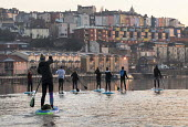 Stand up paddle boarding, Bristol docks - Paul Box - 2010s,2018,activities,boarding,Bristol Floating Harbour,cities,City,DOCK,docks,HARBOUR,Harbourside,Leisure,LFL,LIFE,Outdoor Activity,paddle,paddleboard,paddleboards,paddling,people,person,persons,PHYS