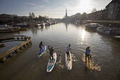 Stand up paddleboarding, Bristol docks - Paul Box - 2010s,2018,activities,Bristol Floating Harbour,cities,City,DOCK,docks,HARBOUR,Harbourside,Leisure,LFL,LIFE,Outdoor Activity,paddle,paddleboard,paddleboards,paddling,people,person,persons,PHYSICAL,PORT