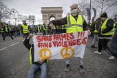 Paris, France Yellow Vest movement protest, Champs Elysees area Banner without armes without violence - Jess Hurd - 08-12-2018