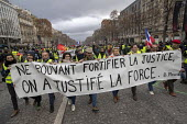 Paris, France protest by Yellow Vest movement, Champs Elysees area. Blaise Pascal quote: Unable to strengthen justice, strength was justified - Jess Hurd - 08-12-2018