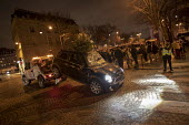 Paris, France protest by Yellow Vest movement, Champs Elysees area. Damaged Mini car with a christmas tree sticking out from the sunroof is towed away - Jess Hurd - 08-12-2018