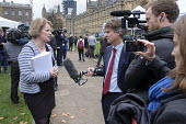 Vicky Ford MP being interviewed by BBC political editor Nick Watt, College Green, Westminster, London, on the day of four ministerial resignations over Brexit deal. - Philip Wolmuth - 2010s,2018,BBC,Brexit,camera,cameraman,cameras,College,COLLEGES,communicating,communication,CONSERVATIVE,Conservative Party,conservatives,employee,employees,Employment,EU,Europe,European Union,FEMALE,