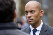 Chuka Umunna MP being interviewed, College Green, Westminster, London, on the day of four ministerial resignations over Brexit deal. - Philip Wolmuth - 2010s,2018,Brexit,Chuka Umunna,College,COLLEGES,communicating,communication,EU,Europe,European Union,interview,INTERVIEWED,INTERVIEWER,interviewing,interviews,journalism,journalist,journalists,Labour