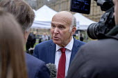 BBC political editor Nick Watt interviewing Vince Cable MP, College Green, Westminster, London, on the day of four ministerial resignations over Brexit deal. - Philip Wolmuth - 2010s,2018,BBC,Brexit,camera,cameras,College,COLLEGES,communicating,communication,democrat,EU,Europe,European Union,filming,Houses of Parliament,interview,INTERVIEWED,INTERVIEWER,interviewing,intervie