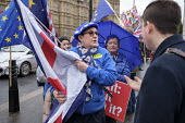 Pro and anti-Brexit protesters arguing outside the Houses of Parliament as MPs debate Brexit deal, Westminster, London. - Philip Wolmuth - 05-12-2018