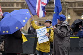 How Would Brexit Benefit Your Family? Anti-Brexit protest outside the Houses of Parliament as MPs debate Brexit deal, Westminster, London. - Philip Wolmuth - 05-12-2018