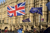 Pro and anti Brexit protesters demonstrate outside the Houses of Parliament on the day Conservative MPs launched a leadership challenge, Westminster, London. - Philip Wolmuth - 12-12-2018