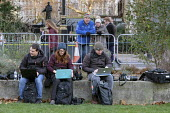 News photographers using laptops to file photos from the media area, College Green, Westminster, London, on the day Conservative MPs launched a leadership challenge - Philip Wolmuth - 2010s,2018,bluetooth,camera,cameras,College,COLLEGES,communicating,communication,COMPUTE,computer,computers,COMPUTING,email,employee,employees,employment,EU,Europe,European Union,FEMALE,freelance,free