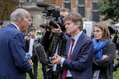 BBC political editor Nick Watt interviewing Vince Cable MP, College Green, Westminster, London, on the day of four ministerial resignations over Brexit deal. - Philip Wolmuth - 2010s,2018,BBC,Brexit,camera,cameraman,cameras,College,COLLEGES,communicating,communication,employee,employees,Employment,EU,Europe,European Union,FEMALE,filming,Houses of Parliament,interview,INTERVI