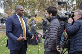 David Lammy MP interviewed by TV journalist, College Green, Westminster, London, on the day of four ministerial resignations over Brexit deal. - Philip Wolmuth - 2010s,2018,BAME,BAMEs,Black,BME,bmes,Brexit,camera,cameraman,cameras,College,COLLEGES,communicating,communication,diversity,employee,employees,Employment,ethnic,ethnicity,EU,Europe,European Union,film