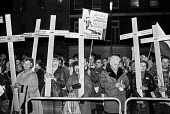 Vigil by the Polish community in protest at martial law in Poland, London 1982, brought in by General Jaruzelski in 1981 to try to crush dissent against the Stalinist regime. Crosses represent workers... - NLA - 1980s,1982,activist,activists,against,anti,army,CAMPAIGN,campaigner,campaigners,CAMPAIGNING,CAMPAIGNS,Catholic,Catholics,christian,christianity,christians,coal miners,collieries,Colliery,Communist,com
