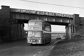 Corby, Northamtonshire, 1982 Graffiti on a railway bridge: Unemployment kills so sack Thatcher, closure of most of the steelworks resulted in a 30% unemployment rate in the town. - Peter Arkell - 13-12-1982
