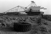 Corby, Northamtonshire, 1982 BSC walking dragline machine for quarrying iron ore lying derelict near the steelworks after most of the works were shut down - Peter Arkell - 13-12-1982