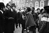 Anger erupts after an arrest. Protest to demand the truth about the death of Colin Roach, Hackney, East London 1982, he was shot in the mouth in the foyer of Stoke Newington police station - Ray Rising - 22-01-1983