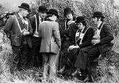 Orange men, Derry, Northern Ireland 1978 wearing bowler hats and lodge regaler gathered in small groups�smoking and drinking before the start of the annual�Londonderry Apprentice Boys parade on 12 Aug... - David Mansell - 12-08-1978